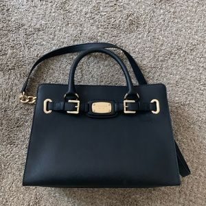 Black and gold Michael Kors purse